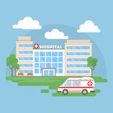 Hospital building with ambulance. Stock Images