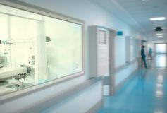 Hospital building indoors with the workers in the hallway.  royalty free stock photography