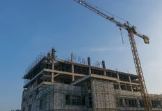 Large hospital construction site with scaffold tower. Royalty Free Stock Images