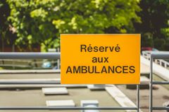 Yellow sign or it is written in French: reserved for ambulances Royalty Free Stock Photos