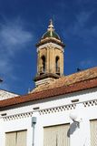 Hospital church bell tower, Aguilar de la Frontera. Royalty Free Stock Images