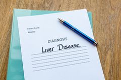 Hospital Consultation Concept - Liver Disease. Liver disease diagnosis written on paper with a folder and pen royalty free stock photography