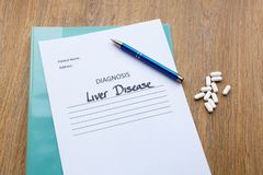 Hospital Consultation Concept - Liver Disease. Liver disease diagnosis written on paper with a folder, pen and tablets royalty free stock image