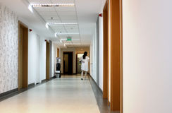 Hospital corridor. Patient walking in the corridor of a hospital Royalty Free Stock Photos