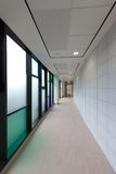 Hospital Corridor. A photo of a new hospital corridor in South Wales showing a worker moving through the corridor Royalty Free Stock Image