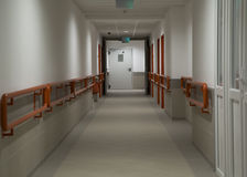 Hospital corridor. Longe hospital corridor with door Royalty Free Stock Photos