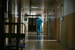 Hospital corridor. Doctor walk in long corridor Stock Images