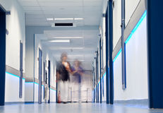 Hospital corridor blurred figures. Blurred figures of nurses walking down a hospital corridor Royalty Free Stock Image