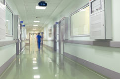 Hospital corridor with blurred figures of the medical staff Royalty Free Stock Photography