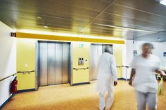 Hospital corridor doctor fire extinguisher motion blur royalty free stock image