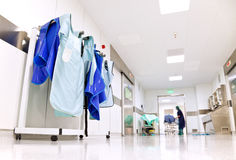 Hospital corridor with doctor protective uniforms Stock Images