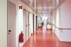 Hospital with corridor and fire extinguisher caregiver royalty free stock photography