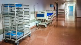 Hospital corridor nobody. Hospital corridor with stretcher and food cart stock images