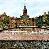 Hospital de Sant Pau, fountain, art and history in Barcelona city, Spain. Flowing water, trees, historic building, time, enchanting architectural details stock photos