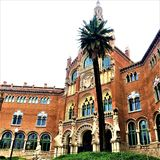 Hospital de Sant Pau, tree, art and history in Barcelona city, Spain. Sky, historic building, time, enchanting architectural details, windows, arches and royalty free stock photography