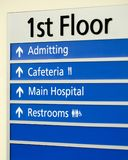 Hospital directory on wall of first floor. Hospital directory indicating various locations Stock Photo