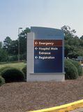 Hospital entrance sign. Sign directing people to the hospital and ER entrance Stock Photography