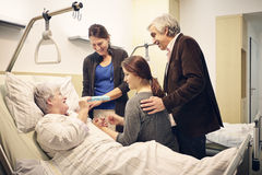 Hospital family medical visit. Hospital visit grandma with the family Stock Photography