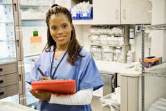 Hospital: Female Nurse In Medical Supply Room Royalty Free Stock Photo