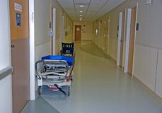 Hospital Gurney & Wheelchair in Hallway Stock Photos