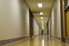 Hospital hallway. Empty, quiet hospital corridor with shiny floor.Low point shooting stock images