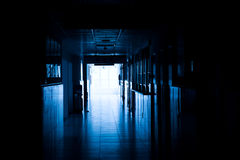 Hospital hallway. Dark blue tone of long corridor in hospital stock images
