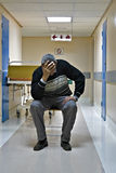 Hospital hallway. Mid age man waiting on the hospital hallway for his wife after surgery, healthcare series Stock Photography