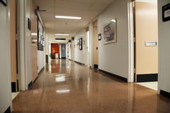 Hospital hallway. With with shiny floor and open door Stock Images