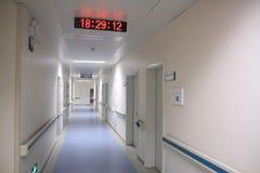 Hospital hallway. With clock and nursing garden cart Royalty Free Stock Photos