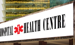 Hospital & health center banner . Hospital and health center banner, caduceus symbol on the modern buildings background stock images