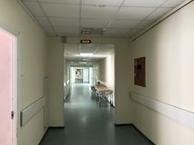 Hospital interior: view of a long corridor with light walls in the hospital stock photo
