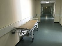 Hospital interior: view of a long corridor with light walls in the hospital royalty free stock image