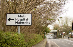 Hospital  and Maternity Road Sign Royalty Free Stock Images