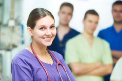 Hospital medic staff. young surgeon doctors team at operation room. Hospital medic staff. Cheerful young female doctor in front of of surgeon at operation room Stock Images