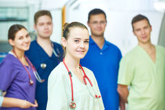 Hospital medic staff. young surgeon doctors team at operation room. Hospital medic staff. Cheerful young female doctor in front of of surgeon at operation room Royalty Free Stock Photo