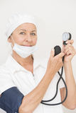 Hospital nurse with blood pressure instrument Royalty Free Stock Photo