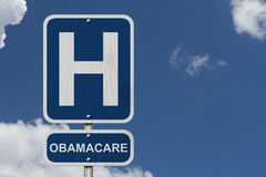 Hospital and Obamacare. Hospitals and Obamacare, a hospital sign with a sky background Royalty Free Stock Photography