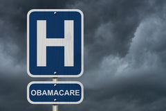 Hospital and Obamacare. A stormy sky background with a hospital sign and word Obamacare, Medial Insurance and Obamacare Stock Photo