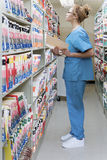 Hospital orderly in archives stock image