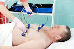 Hospital patient at electrocardiogram Royalty Free Stock Photos
