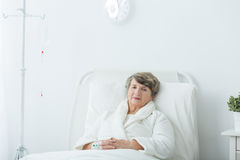 Hospital patient during treatment Stock Image