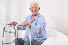 Hospital patient with a walking frame stock images