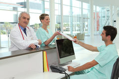 Hospital reception area. Staff gathered in hospital reception area royalty free stock photo