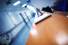 Hospital reception with blurred silhouette.  royalty free stock image