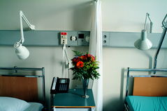 Hospital room with beds. A view of a modern, semi-private hospital room with two beds royalty free stock photos