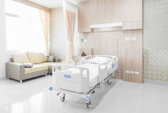 Hospital room with beds and comfortable medical equipped in a mo Royalty Free Stock Image
