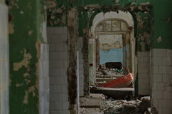 Hospital ruins. Interior of an old hospital ruins in soft light royalty free stock image