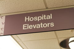 Hospital sign: Hospital Elevators. A sign on a ceiling stating Hospital Elevators Royalty Free Stock Photo