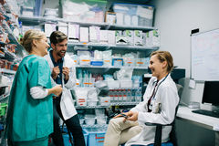 Hospital staff having casual discussion in the pharmacy Royalty Free Stock Photos