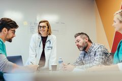 Hospital staff meeting in conference room Royalty Free Stock Photo